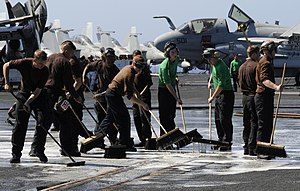 US Navy 111223-N-RG587-433 Sailors scrub the flight deck of the Nimitz-class aircraft carrier USS Carl Vinson (CVN 70).jpg