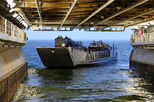 US Navy 120109-N-GF386-064 Landing Craft Utility (LCU) 1654, assigned to Assault Craft Unit 2, departs the well deck of the amphibious assault ship.jpg