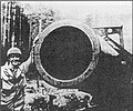 US Soldier with 800mm gun dora.jpg