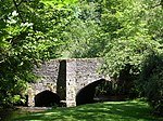 Packhorse bridge 75 m south east of The Old Vicarage
