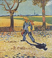 man wearing a straw hat, carrying a canvas and paintbox, walking to the left, down a tree lined, leaf strewn countryroad