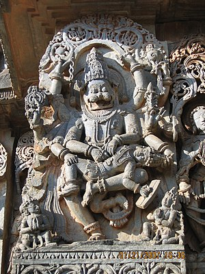 Narasimha - Viṣṇu as Narasiṃha kills Hiraṇyakaśipu, stone sculpture from the Hoysaleswara Temple in Halebidu, Karnataka