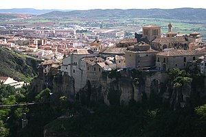 Cuenca, Spain - View of Los Canónigos, Casas Colgadas (in the foreground), San Pablo Bridge (bottom left) and Downtown Cuenca (background), as seen from Palomera highway