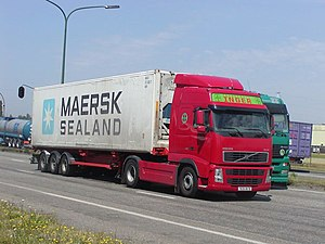 A container truck. Cab-over design.