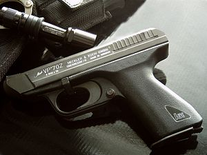 Safety (firearms) - Heckler & Koch VP70 pistol with a push-button safety (cross bolt trigger block) at the back of the trigger guard