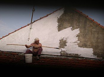 English: Wall painting house painter Español: ...