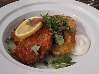 Wiener schnitzel - Whereas the original Austrian Wiener schnitzel only includes lemon and parsley as garnishes, in the Nordic countries it is typically also garnished with a slice of anchovy and capers.