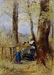 Mutter mit Kind in Frühlingslandschaft