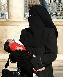 Woman wearing niqab with baby