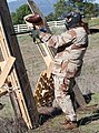 Woman with Spyder-like paintball marker participating in paintball match.jpg