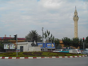Yüreğir - Karacaoğlan statue at the major intersection