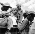 """... troops in Burma stop work briefly to read President Truman's Proclamation of Victory in Europe."", 05-09-1945 - NARA - 531341.tif"