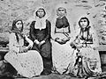 Женщины в будничных одеждах. На головах - традиционные грузинские головные уборы таксакрави. Грузия. Грузины.JPG