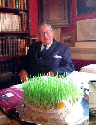 Peter Avery - Peter Avery in his office in the King's College, Cambridge posing in front of the Persian New Year table of Haft-Seen By: Ali Akbar Abdolrashidi