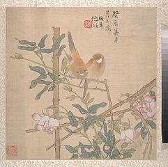 Two Birds Perched on a Flowering Rose Bush