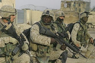 1st Battalion, 8th Marines - U.S. Marines prepare to step off on a patrol through the city of Fallujah, Iraq, to clear the city of insurgent activity and weapons caches as part of Operation al Fajr (New Dawn) on Nov. 26, 2004.