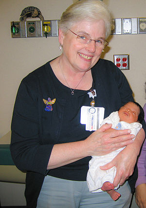 Mary Rose Tully - Mary Rose Tully with a 17-day-old patient at UNC Hospital, Chapel Hill, December 8, 2008.