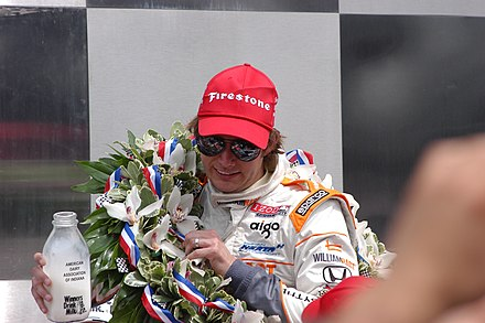 2011 Indianapolis 500 winner Dan Wheldon holding a bottle of milk 2011 Indy 500 Winner - Dan Wheldon.jpg