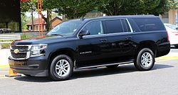 2015 Chevrolet Suburban LT in black, front left side view.jpg