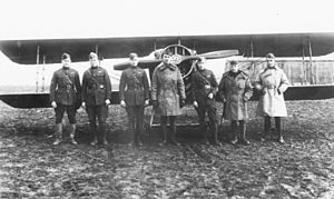 213th Aero Squadron - Lt. Charles Grey (Center) and pilots of the 213th Aero Squadron, and a SPAD XIII, Foucaucourt Aerodrome, France, November 1918