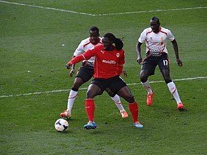 Kenwyne Jones - Jones being challenged by Aly Cissokho and Mamadou Sakho in 2014