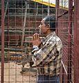A devotee praying outside a mandir.jpg