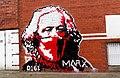 A graffiti mural of Karl Marx wearing a bandana on the side of NIAMOS community centre.jpg