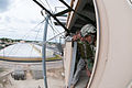 A jumpmaster readies an Indian Army paratrooper to exit a 34-foot parachute training tower at Fort Bragg in 2013.jpg