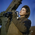 A member of the ATS (Auxiliary Territorial Service) serving with a 3.7-inch anti-aircraft gun battery, December 1942. TR452.jpg