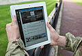 A serviceman accesses social media channels using an iPad, outside MOD Main Building in London MOD 45156049.jpg