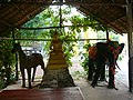 A shrine with animals an a buddha sculpture.JPG