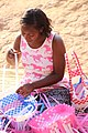 A woman is creating marketing basket.jpg