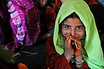 A young Afghan girl smiles shyly .jpg