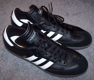 Adidas Samba - A pair of black Adidas Samba sneakers.