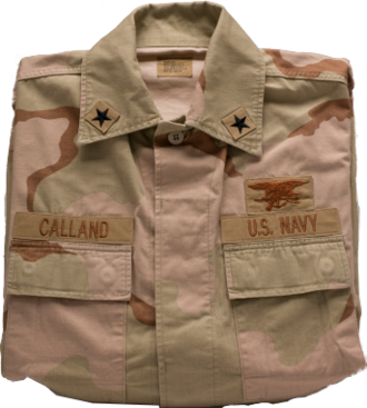 Desert Camouflage Uniform - A folded and buttoned U.S. Navy DCU blouse.