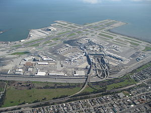 Spaghetti Junction - An aerial view of San Francisco International Airport near San Bruno, California. A spaghetti junction connects the passenger terminal roads to US 101.