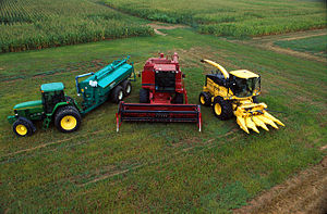 Agricultural machinery - From left to right: John Deere 7800 tractor with Houle slurry trailer, Case IH combine harvester, New Holland FX 25 forage harvester with corn head.