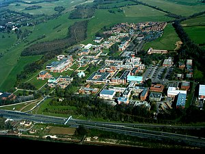 University of Sussex - Campus from above in 2004. There have since been expansions most notably on central campus with the addition of the Jubilee building, which is the home of the business school, and the Swanborough student residences. The far north of campus is now where the Northfield residences are located