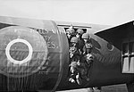 Airborne troops smile from the door of their Horsa glider as they prepare to fly out as part of the second drop on Normandy on the night of 6th June 1944. H39182.jpg