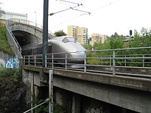 Airport Express Train at Etterstad out of the Romerike Tunnel.jpg
