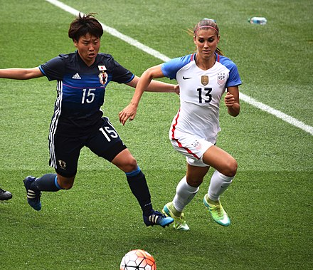 Morgan being challenged by Hikari Takagi (15) and Ayaka Yamashita (12) during a match against Japan in Cleveland on June 5, 2016 Alex morgan 2016.jpg