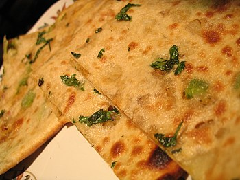 Picture of aloo (potato) paratha lying on a ta...