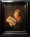 Amsterdam - Rijksmuseum 1885 - The Gallery of Honour (1st Floor) - Portrait of an old woman reading the Bible c. 1630-35 by Gerrit Dou.jpg
