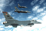 An air-to-air right side view of a three-ship echelon formation of F-16 Fighting Falcon aircraft DF-ST-83-07625.jpg