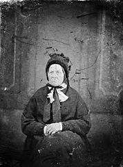 An old woman wearing a hat