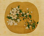 Blossoms and leaves on a branch painted on an oval background.