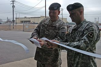 15th Sustainment Brigade - The brigade commander, Colonel Larry Phelps and the commander of the 49th Transportation Battalion cut a ribbon for a completed project during Operation Iraqi Freedom in February 2008.