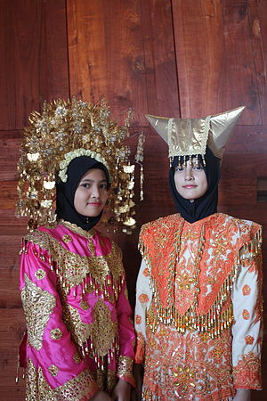 Overseas Minangkabau - Malaysian girls in traditional Minangkabau attire at the Istano Silinduang Bulan, Tanah Datar Regency, West Sumatra, Indonesia.