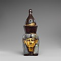 Attachment in the form of the head of a goddess wearing the double crown MET DP139128.jpg