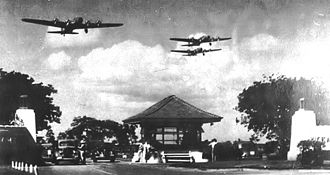 Hickam Air Force Base - Boeing B-17D Fortresses of the 5th Bombardment Group overfly the main gate at Hickam Field, Hawaii Territory during the summer of 1941. 21 B-17C/Ds had been flown out to Hawaii during May to reinforce the defenses of the islands.